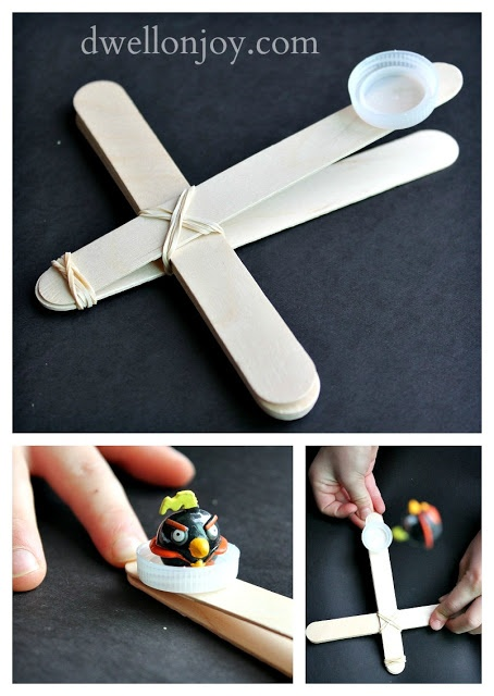 Angry Birds Catapult! Make a large one for outdoors using sticks and bungee cords. Try to hit at bulls eye!