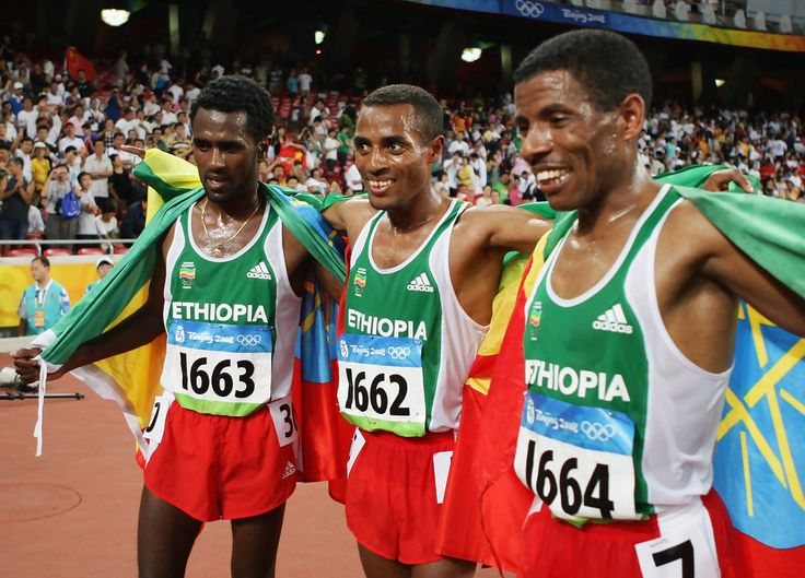 After the 10,000m. in the Beijing Olympics in 2008, (L-R) Seleshi Sihine (silver medal) of Ethiopia, Kenenisa Bekele (gold medal) of Ethiopia are congratulated by teammate Haile Gebreselassie of Ethiopia after the Men's 10000m Final in the Men's 10000m Final held at the National Stadium on Day 9 of the Beijing 2008 Olympic Games on August 17, 2008 in Beijing, China. Kenenisa Bekele of Ethiopia finished the event in first place with a new Olympic record time of 27:01.17.