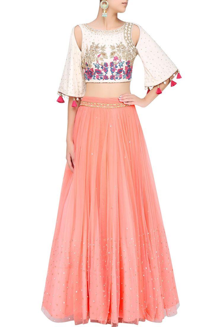 Ivory shoulder cut out embroidered crop top with rose pink skirt by MONIKA NIDHII #MONIKANIDHII #Designer #Skirt #CropTop