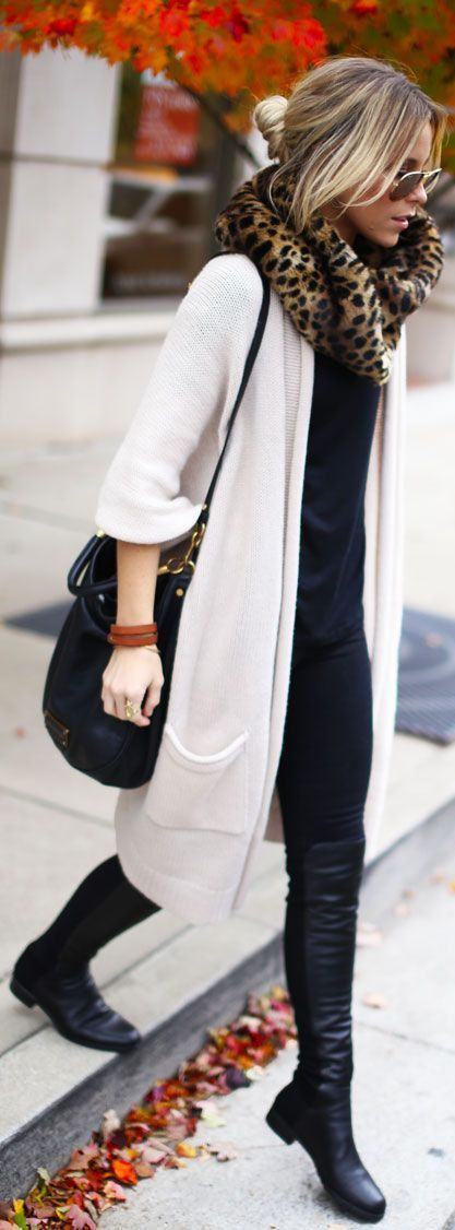 Knee high black boots + black jeans + black shirt + leopard scarf + white long cardigan