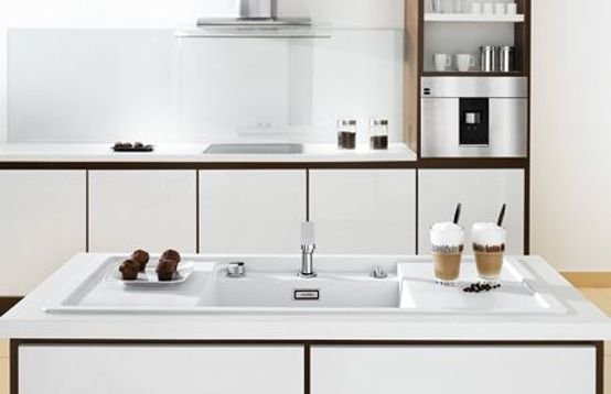 Minimalist Kitchen Sinks with Movable Cutting Board and Retractable Faucets | DigsDigs        Retractable faucets... finally