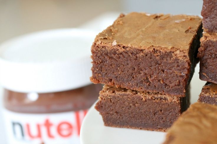 These are seriously the best Nutella Brownies you'll ever make! They're so rich and chocolatey with a classic flakey top. Yum!