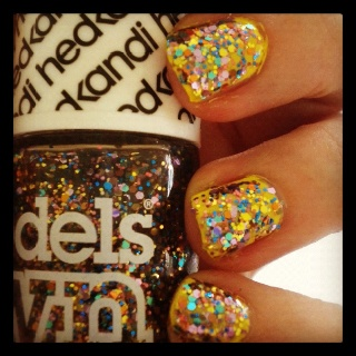 Models Own Ibiza Mix over a Miss Sport yellow polish. For more info visit www.colouratyourfingertips.blogspot.co.uk