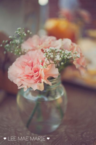 simple vase of carnations to decorate a peach & yellow dessert table. leemaemarie.com
