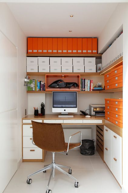 Colour coded organisation in a Contemporary Home Office by Juliette Byrne. Neat.