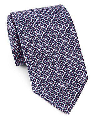Salvatore Ferragamo Mini Elephant Silk Tie | A woven dress staple, full of color and character, in fine Italian silk.