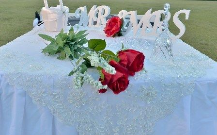 Eternal Weddings Décor and Photography. Wedding Signing Table. Decorations. Red Long Stem Roses. Mr and Mrs Wedding Sign. Flower Girl Basket. Crystal Beaded Cloth. Crystal Bell. Scatter Gems