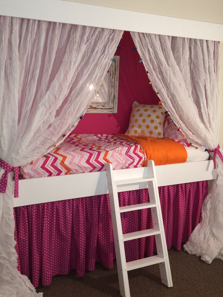Loft bed built into closet with storage house