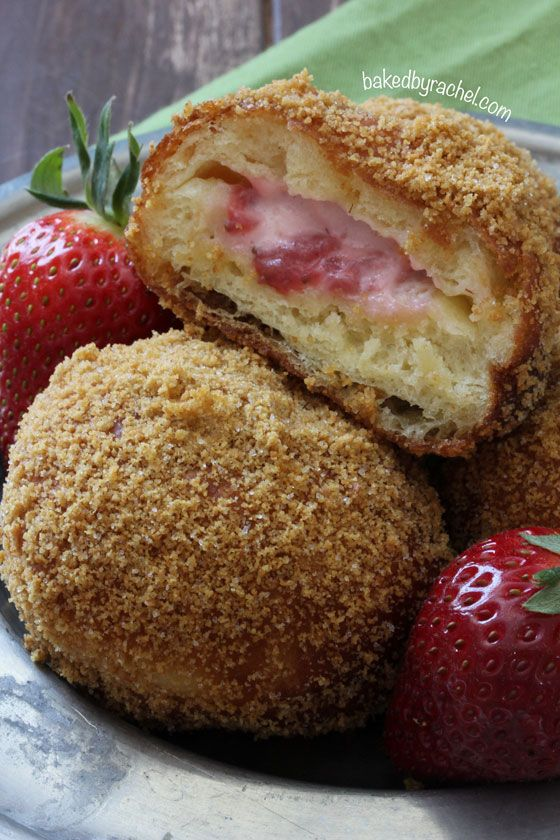 Strawberry Cheesecake Donut Recipe ~ Homemade fried yeast donuts featuring a warm strawberry cheesecake center and a graham cracker crumb coating