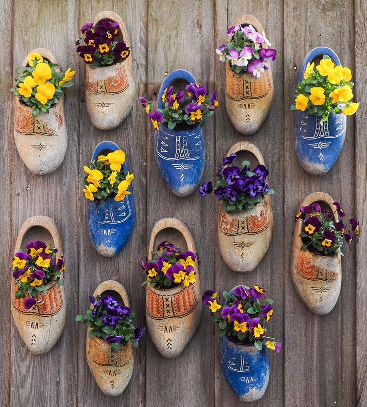 Dutch wooden shoes make great planters for fence.  Photo via Derk De Wit