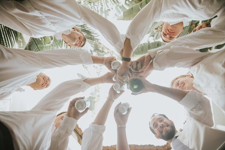Cheers to the groom and groomsmen in this fun portrait from a Playacar Palace #destinationwedding