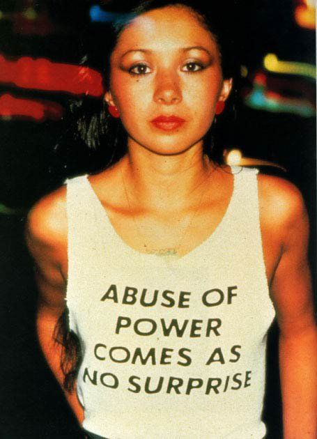 "This is Lady Pink, one of the only female graffiti artists active in the '80s. Jenny Holzer, famous for her feminist postmodern ""Truisms,"" designed this shirt and Lady Pink wore it around NYC. Someone needs to re-release this tee..."