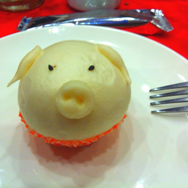 Asian Cuisine Desserts Of Chinese Dessert Pig Shaped Bread With Salted Egg Custard