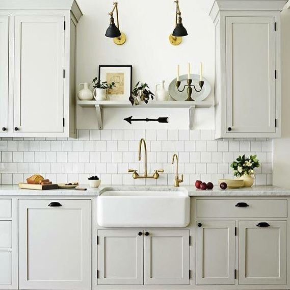 "We are getting close to point of the workshop being ready enough to move alllll the stuff out of The Little Cottage, and that has me in high ""inspiration collection"" mode. I'm liking the double lights and the shelf over the sink from this @housebeautiful kitchen. We too have a very similar set up with the way the cabinets are hung, and no window over the sink, so I'm contemplating ideas for that. I'll file this one away for sure."