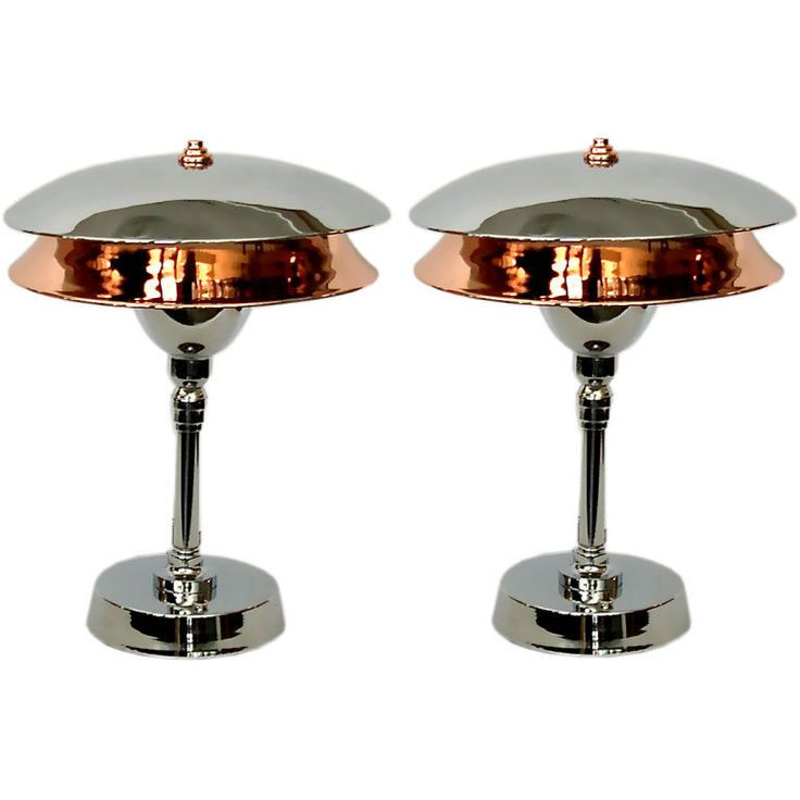"Pair of Chrome & Copper Two Tiered Art Deco Aviator"" Table Lamps  United States  1930's  These great 1930's machine age lamps were featured in the film, ""The Aviator"". When lit, the lower copper shade illuminates from the reflection cast by the top chrome shade. The effect is very dynamic."