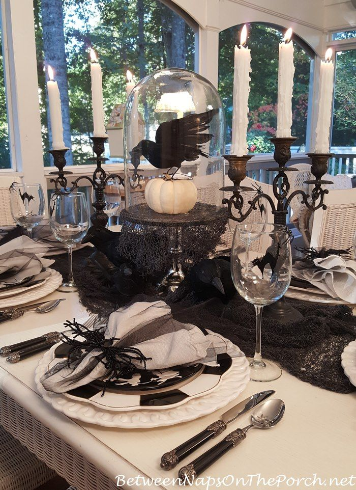 halloween table setting with whimsical black and white from between naps on the porch
