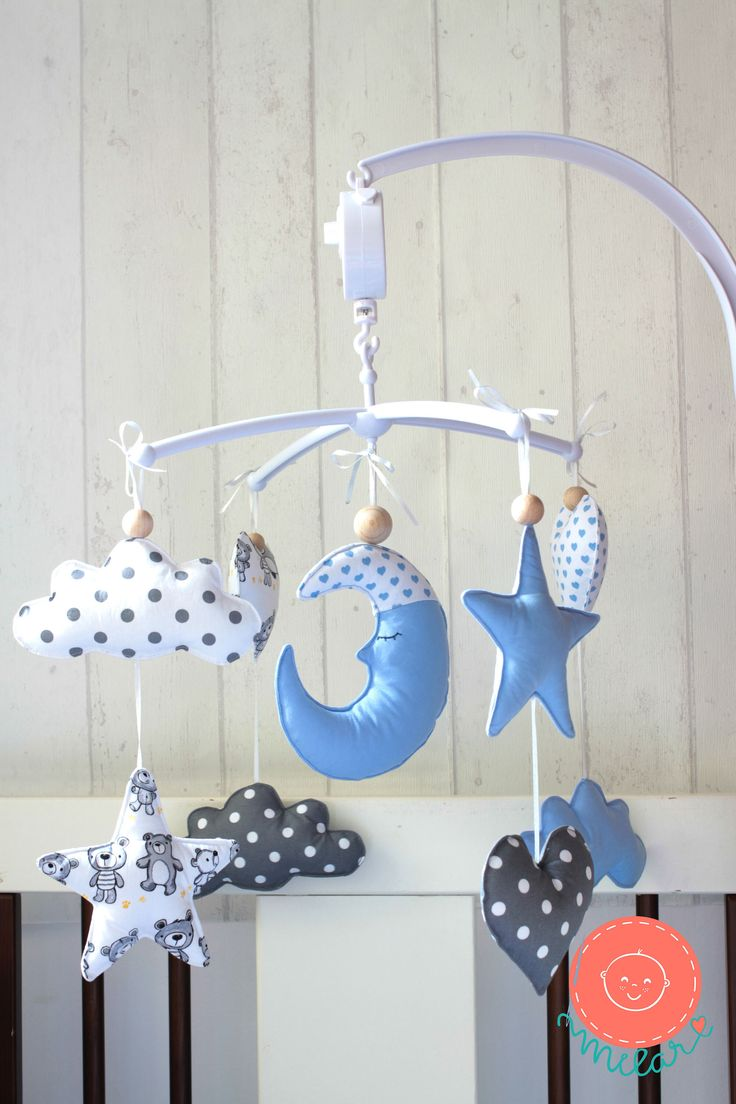 A personal favorite from my Etsy shop https://www.etsy.com/listing/567753339/moon-star-cloud-mobile-baby-mobile-moon