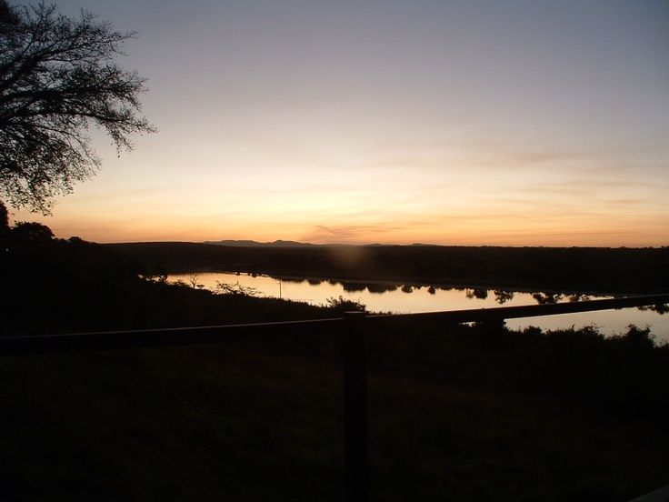 View from the game lodge of the sunset over the Crocodile River in Kruger Park South Africa.