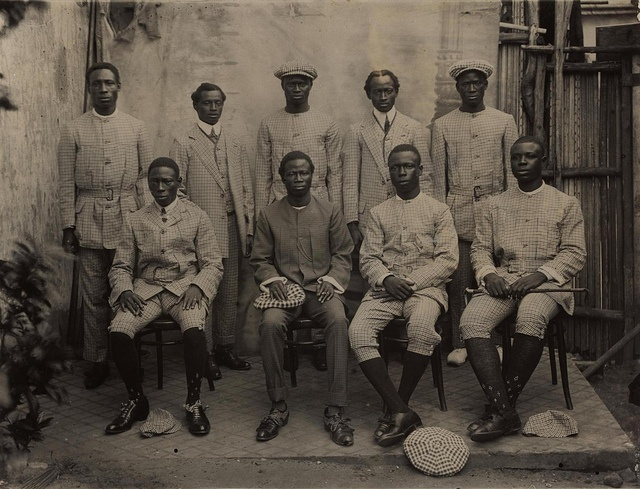 """""""Where Ignorance is Bliss"""" Lagos Boys, via Flickr ca 1910s Picture shows a group of men in suits in Lagos, Nigeria. From a two volume set of photographic albums containing 130 photographs. Photographs depict representatives of the Paterson Zochonis trading company and the various tribes they encountered in the course of trading in West Africa.:"""