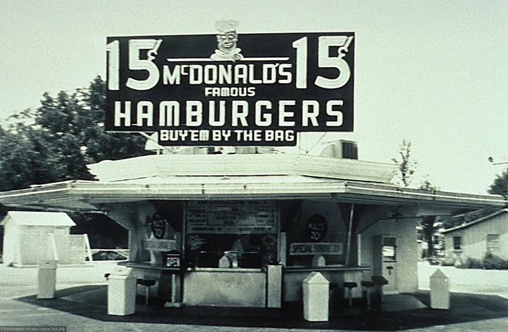 "The original hexagonal McDonalds brothers' restaurant located at 1398 North E Street in San Bernardino, California (1954). This stand was demolished in 1957 to be replaced by a building in the Golden Arches style. In an oversight, the McDonald brothers failed to retain rights to the McDonald's name when they sold the chain to Ray Kroc, and they were forced to rename it ""The Big M"". It went out of business and was demolished in the 1980s, although part of the sign remains."