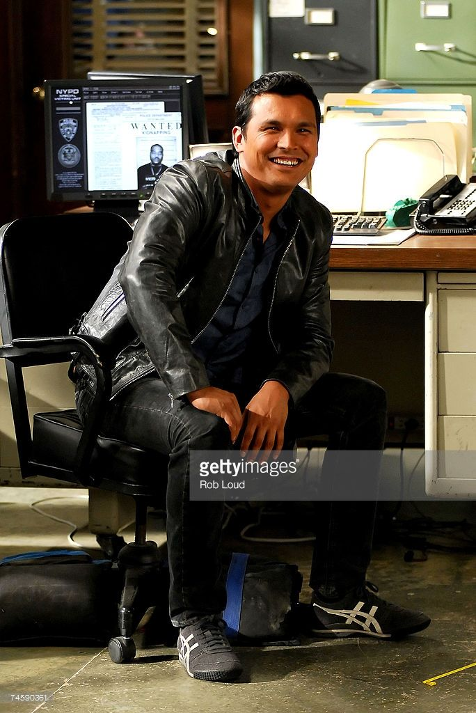 Actor Adam Beach who plays Detective Chester Lake sits on the set of 'Law &…