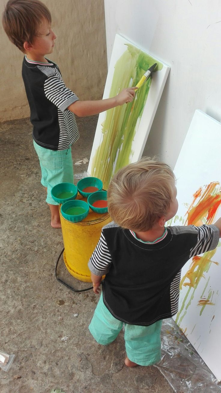 My grandchildren busy painting grandma's canvas for oil paintings.