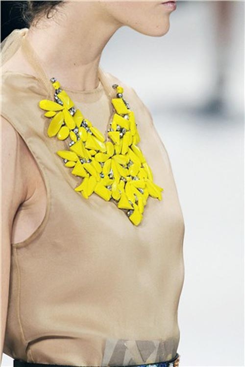 I would love this necklace.  It is the perfect pop of color for that outfit.