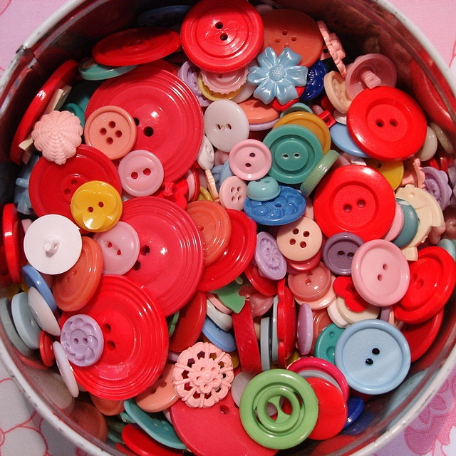 buttons buttons buttons  oh my!!! my grandma had jars of buttons that i used to play with when i was little... looove this