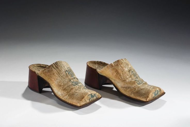 """A History Of Men In Heels In 18 Stunning Pairs #refinery29  http://www.refinery29.com/history-of-men-in-heels#slide-7  Men's mules, English, c. 1690-1715""""Men and women wore distinctly different heels by the end of the 17th century. Whether stacked or leather-covered, men's heels were typically broad and sturdy. Women's heels, in contrast, were most often leather-covered and very narrow. This pair of men's mules would have been worn at home as part of a gentleman's undress."""""""