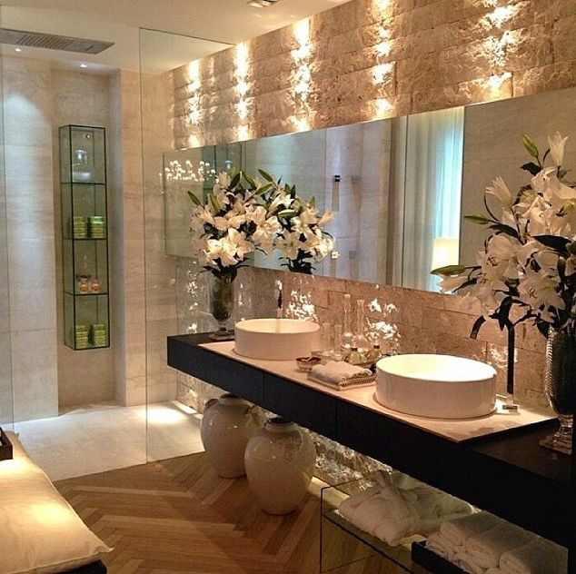 Picture Gallery For Website An elegant oval mirror gives the linear bathroom a hint of curves Satin nickel
