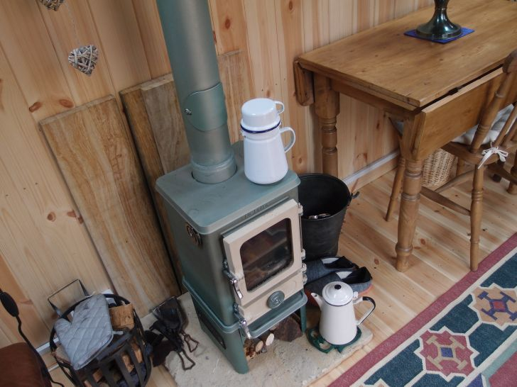 "Woodburning stove ""The Hobbit"" 4KW stove by Salamander stoves.  This stove is specifically designed for use in a narrow boat or other small spaces like a She Shed"