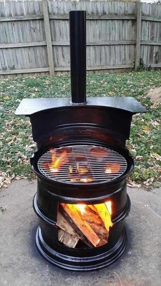 Repurposed old car tire rims into a backyard grill.
