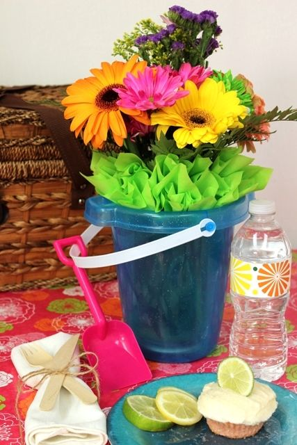 Beach picnic flowers and flower centerpieces on
