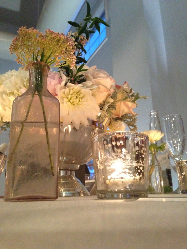 Wedding table decor mercury votive candles and bud vases for Flower centerpieces for living room tables