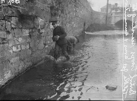 British soldiers searching the River Tolka in Dublin for arms and ammunition after the Easter Rising