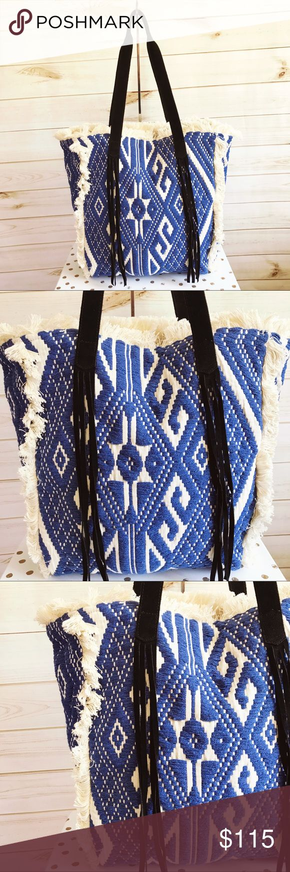 """Raj Blue Isabella Frayed Tote Stunning, large cream tote bag w/gorgeous bright blue embroidery. Features frayed details along sides/top of bag; black suede straps & long, suede, fringed details on front of bag at bottom of straps; interior zip pocket; two small interior pocket. BRAND NEW item w/tags & is SOLD OUT in this color combo! 14""""L x 17.5""""H x 5""""W. Made in India. Pricing on Boutique items is FIRM. Many vendors do not provide tags. This item is a brand new item from a vendor & is tagged…"""