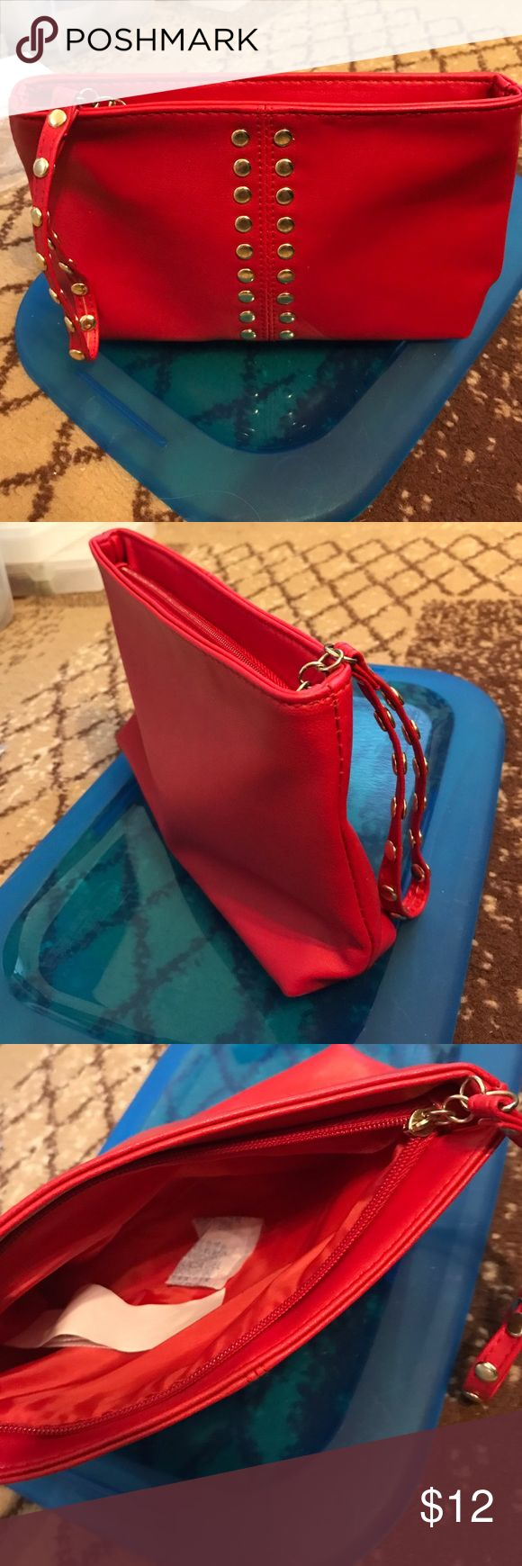 """Red studded faux leather make up bag. BNWT. Measures from the bottom: 8"""" x 2"""" and 6"""". Tapers upwards to where it zippers at top. A soft feeling leather. Gold tone hardware. Strap: 5.5"""". You can never have enough bags, in my opinion. This is a great red to add a splash of color to any outfit. BNWT. You can use this as a cosmetic bag or clutch to carry around. Bags Clutches & Wristlets"""