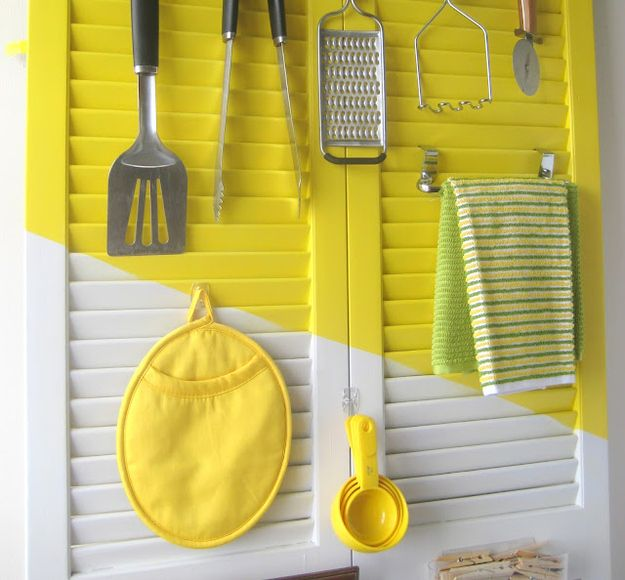 Arrange utensils and cloths on an old shutter door. | 30 Insanely Easy Ways To Improve Your Kitchen