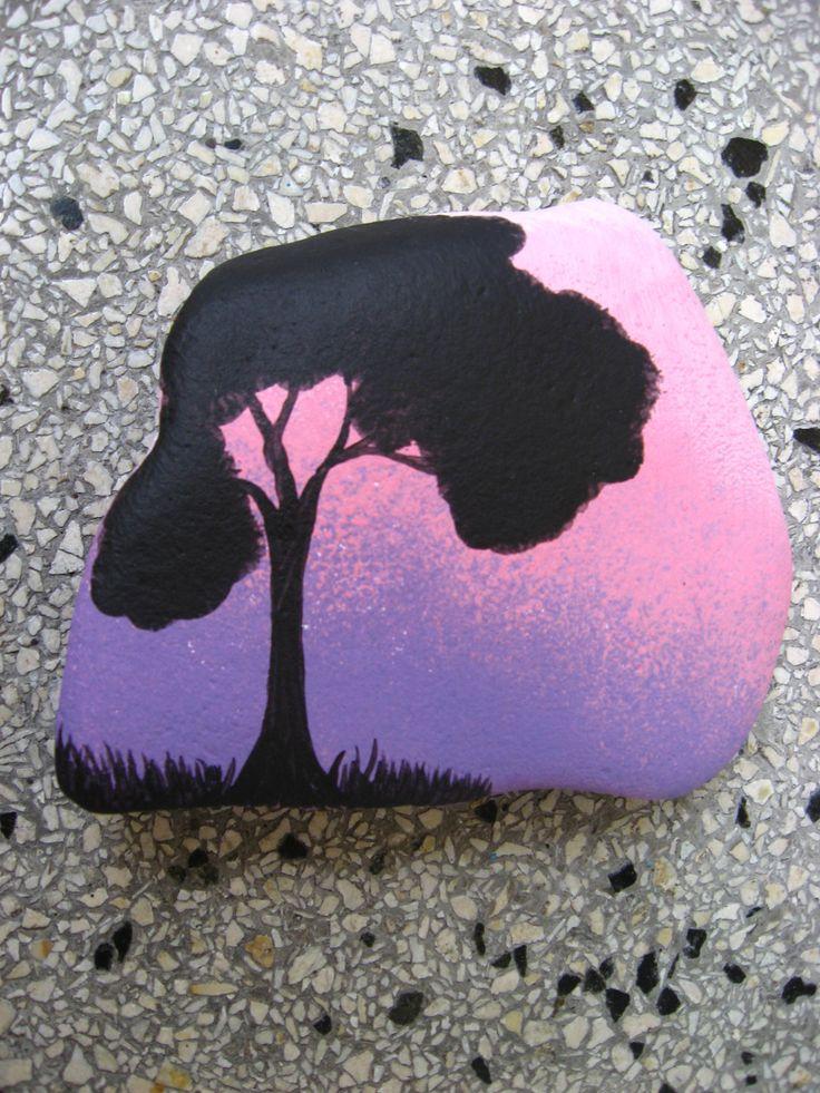 Black tree onpurple/pink sunset rock