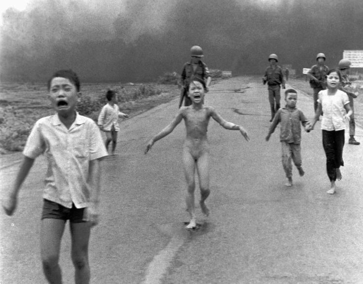 South Vietnamese forces follow after terrified children, including 9-year-old Kim Phuc, center, as they run down Route 1 near Trang Bang after an aerial napalm attack on suspected Viet Cong hiding places on June 8, 1972. A South Vietnamese plane accidentally dropped its flaming napalm on South Vietnamese troops and civilians. The terrified girl had ripped off her burning clothes while fleeing. The children from left to right are: Phan Thanh Tam, younger brother of Kim Phuc, who lost an eye…