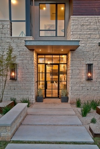 Industrial style entry, cast iron front door.