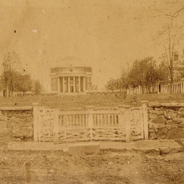 "From 1868: The earliest known photograph of the Rotunda, taken shortly after the Civil War. The gate is a ""cow-catch"" to prevent livestock from grazing on the Lawn (unless the groundskeeper decided it needed trimming). The controversially open-ended south end of the Lawn enabled easy access for hungry cattle. #UVA #OnGrounds #oldschool"