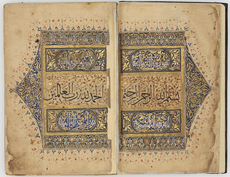 """Beautifully illuminated volume contains Surat 1 Al-Fatihah (The Opening), with the first verses only here - the opening Bishmillah on the right, and on the left the first verse: """"Praise be to God lord sustainer of the worlds."""" (Michael Sells trans.) Also (not pictured here) suras: An'am (6), Kahf (18), Saba' (24) & Mala'ikah (35) aka Fatir. Fatiha here on a ground of feathery spiral scrolls, panels above & below. Iran, probably Safavid Shiraz, 16th century AD. (Audrey Shabbas)"""