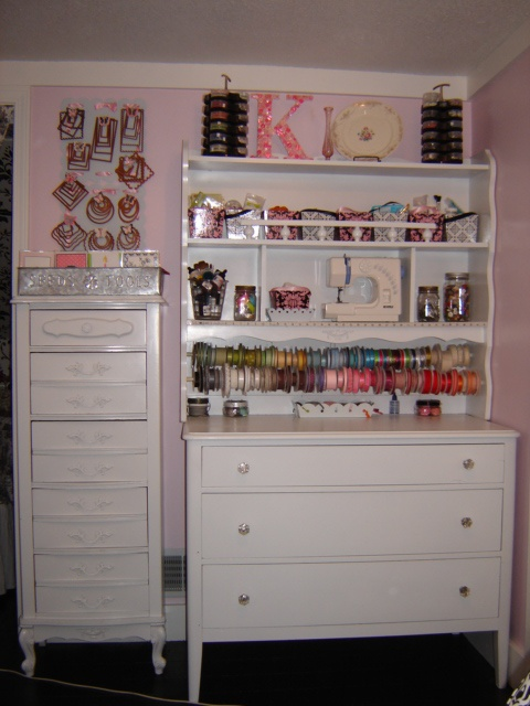 Here are some other furniture pieces in the room.  The hutch & dresser are great storage.  The hutch came from the same desk set and the dresser is from a thrift store.  Both were spray painted white.  The tall dresser next to it is from the same girl's bedroom furniture.  It is used as punch storage. The metal boards above it hold my nesties and I made butterfly clothespin magnets to hold them on there.