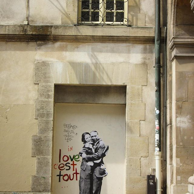 """🇫🇷 """"In love c'est tout"""" Love is everywhere in Paris, liberal and free - love is all you need ❤ #placedesvosges #lemarais #visitparis #4tharrondissement #3rdarrondissement #paris #love #inlovecesttout #melbournelifelovetravel #streetart #loveit #throwback #takemeback  #scenery #april #spring #instaparis #instafrance #visitparis #love #explore #live #travel #instagood #instatravel #loveisallyouneed #freedom #liberal #free"""