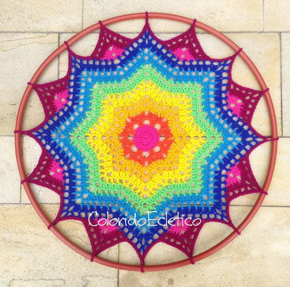 This pattern is for a colorful doily made with wool yarn, for hook 5 mm. About 24 in diameter. Instructions easy to understand. This pattern is
