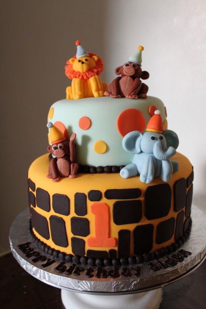 Safari First Birthday Cake - molding circus animals out of fondant