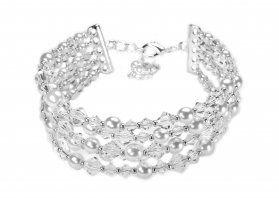 Bransoleta 5-rzędowa połączenie białych, szklanych perełek z pięknymi, błyszczącymi kryształami. Rozmiary 4-6 mm.