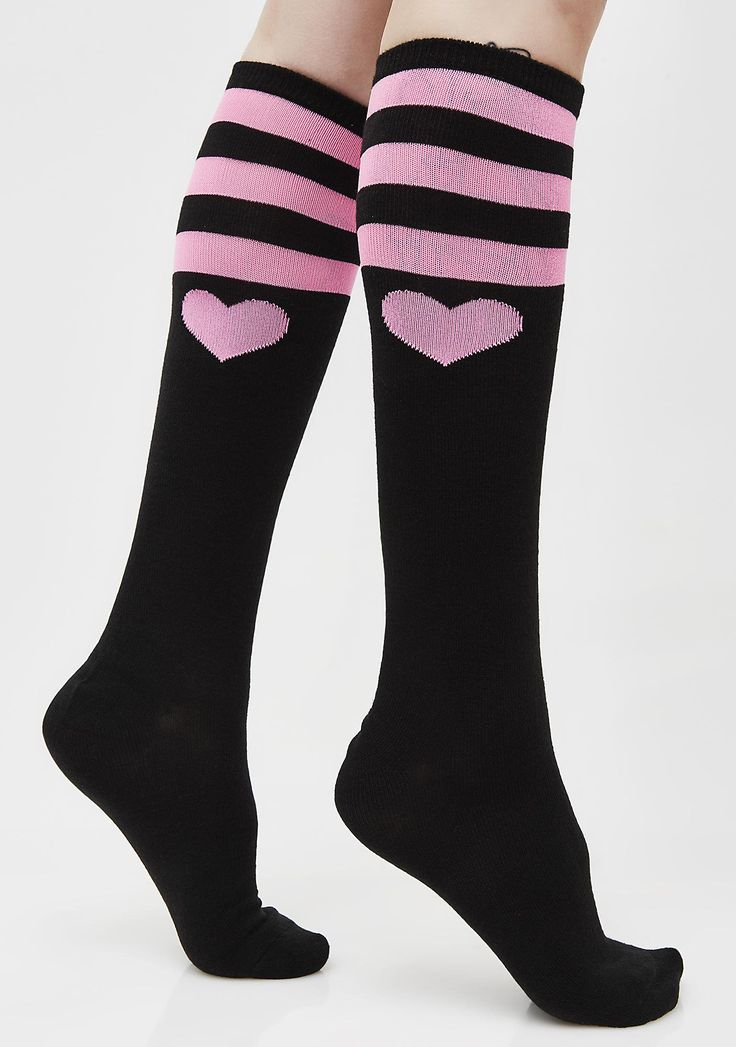 Tough Heart Striped Knee Socks are a sweet treat for yer feet! These lovable knee high socks have a wide ribbed top band right below the knees that are slightly stretchy so they will stay up, without cutting off yer circulation. With three pink stripes and a cute pink heart below the knees, you'll be able to show a little love for yer legz, while gaining a few new admirers. #dollskill #valentinesday #hearts #pink #red #valentinesgiftideas