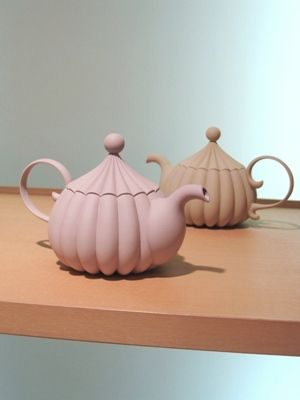 I love these tea pots so cute I imagine this is what Mrs Potts would look like